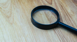 Magnifying glass on floor